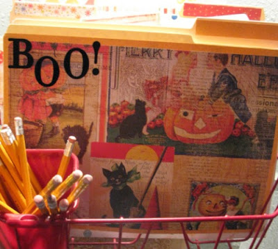 Halloween decorated file folder with pencils in the silverware holder of the dish drainer for the cheap file folder idea