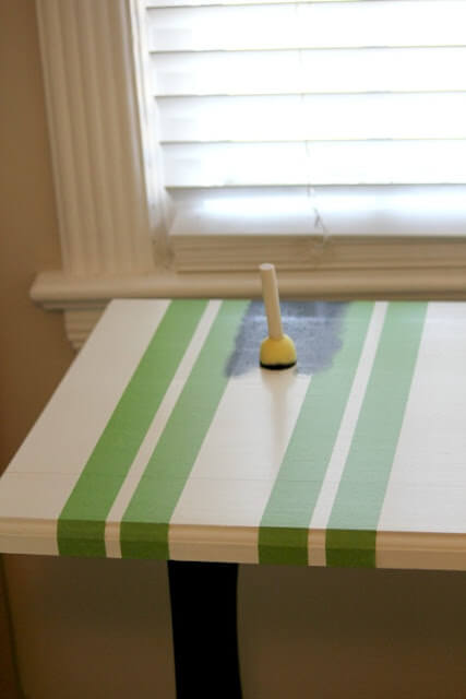 Wood and metal table after Frogtape has been applied. I'm beginning to paint with a foam stencil brush