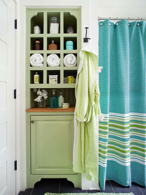Light green storage cupboard in bathroom