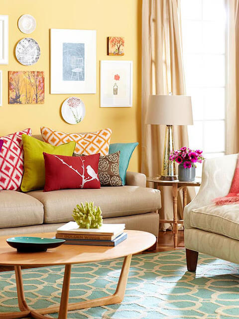 Colorful cottage style living room with couch and chair
