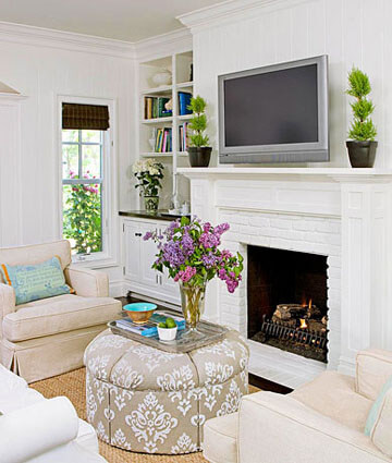 A grouping of furniture in a living room arranged in a cozy fashion for conversation.
