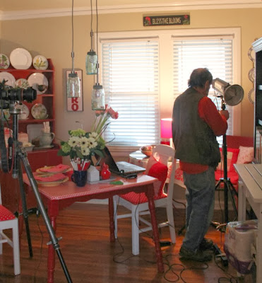The photographer in my dining room setting up his equipment to take photos for the magazine. Now I know what happens at a magazine photo shoot.
