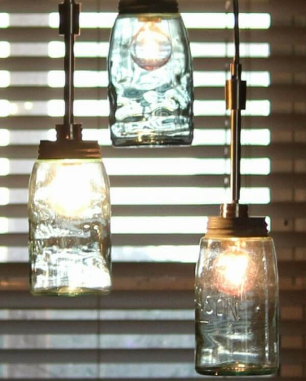 The vintage mason jar dining room lights I hung from the ceiling