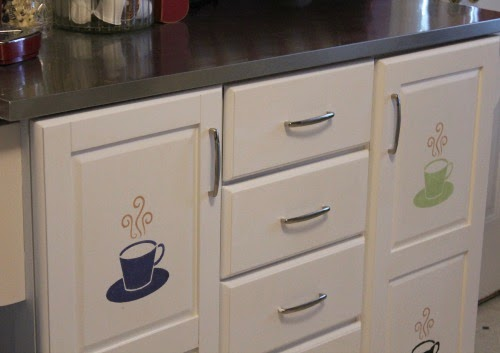 The white kitchen rolling cart I rescued from the trash and stenciled coffee cups on the doors is one of the projects
