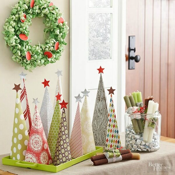your holiday tree can be a grouping of paper made assemblages you can use scrapbook paper of your choosing and assemble a christmas tree similarly shaped