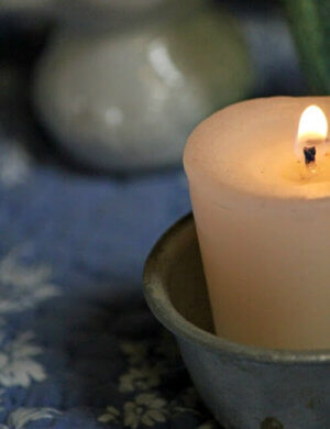 votive candle in tin