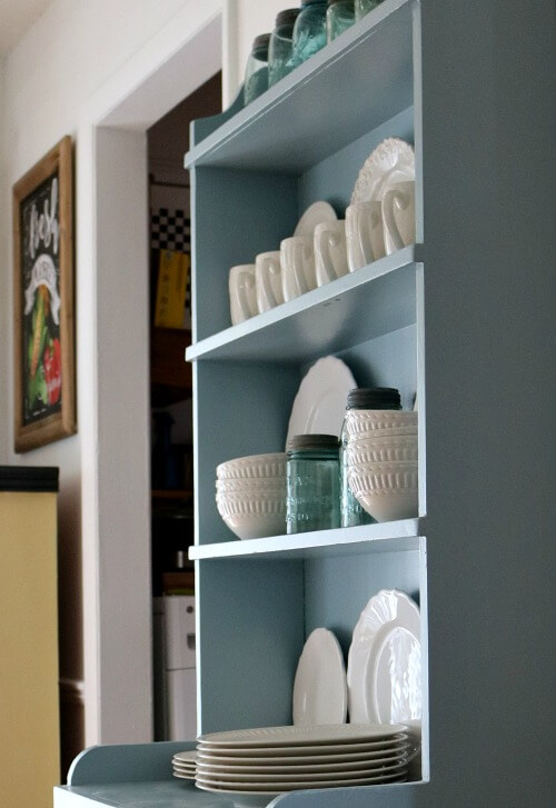 Blue cupboard with white dishes