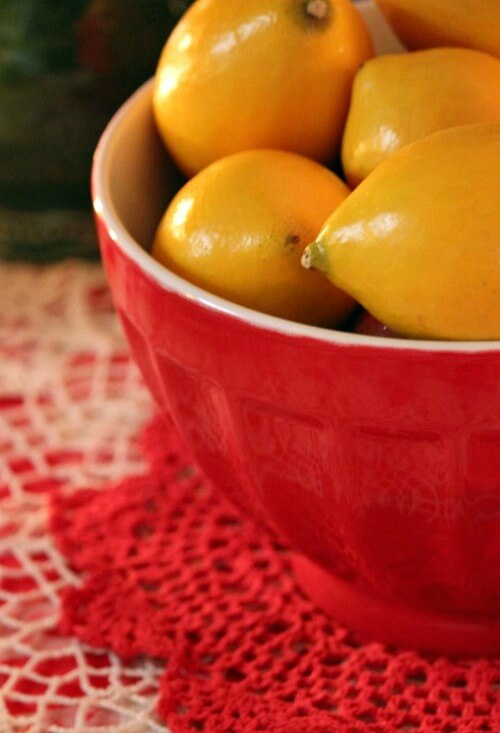Red bowl of lemons