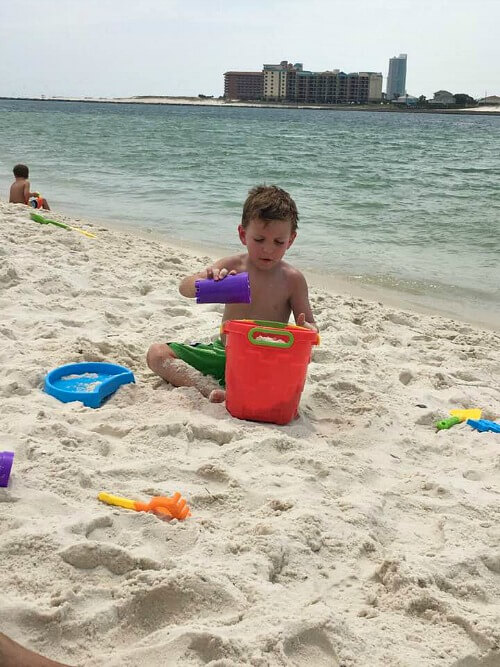 Andrew playing in the sand