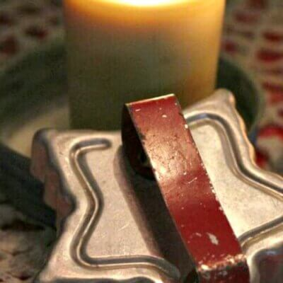 candle with vintage star cookie cutter