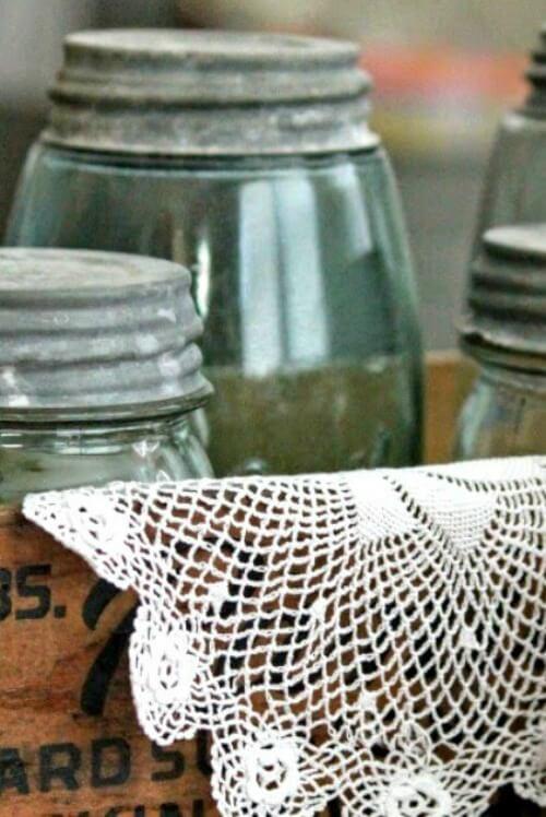 Vintage box with mason jars inside and a doily