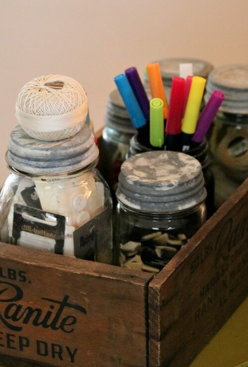 Vintage jars of craft supplies