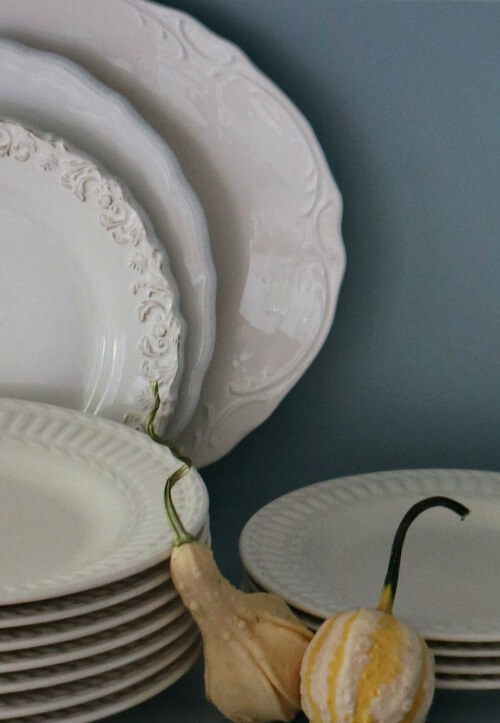 White dishes with fall decor