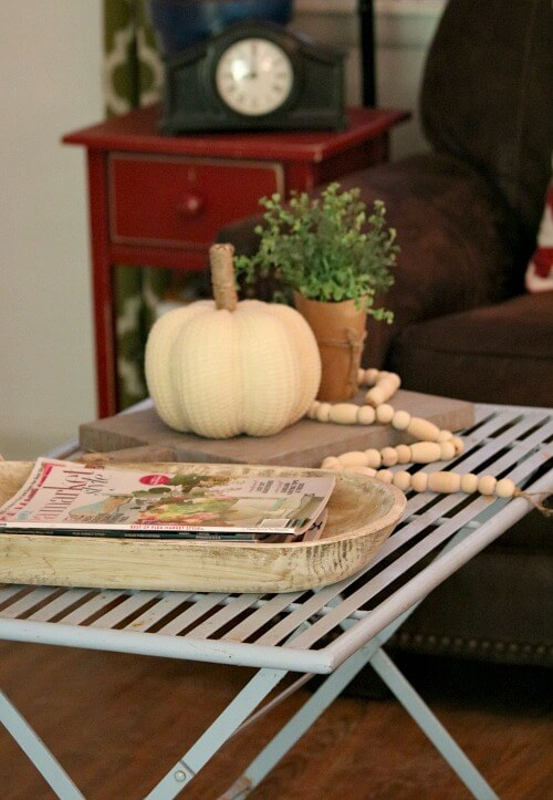 Neutral fall decor on coffee table
