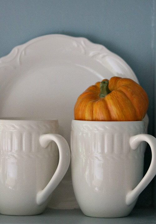 Fall mini pumpkin on my hutch