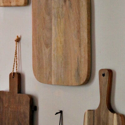 Cutting boards hanging on kitchen wall