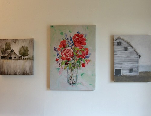Canvas paintings on dining room wall