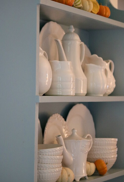 blue hutch with white dishes