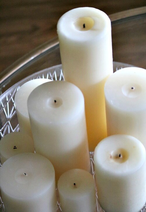 Grouping of white candles