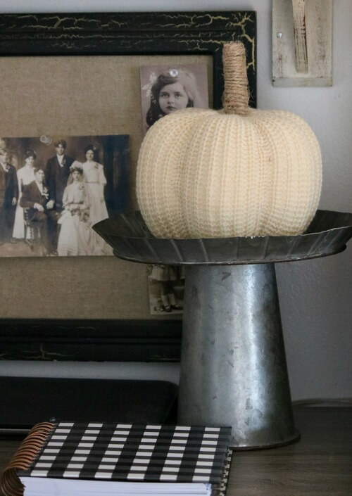 Sweater pumpkin on stand