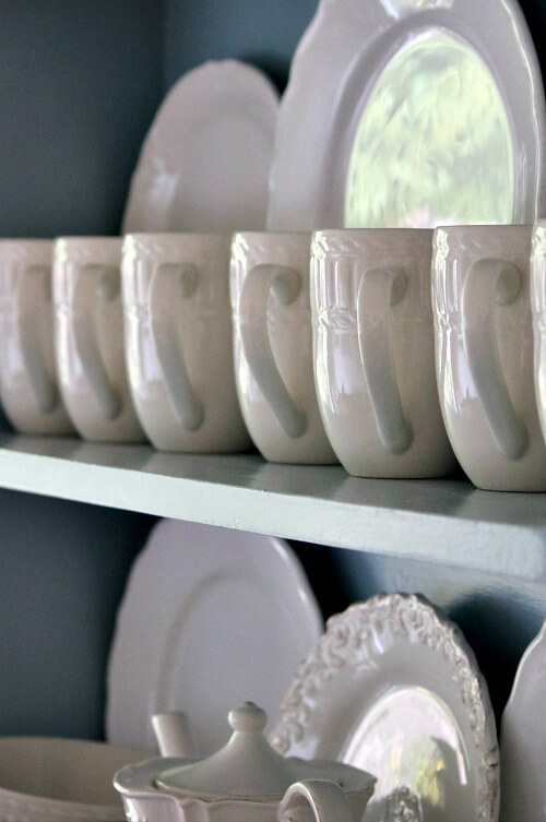 White dishes in blue hutch