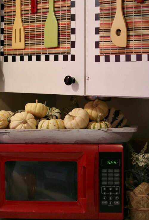 Microwave with fall gourds on top