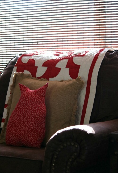 living room chair with quilt and pillows