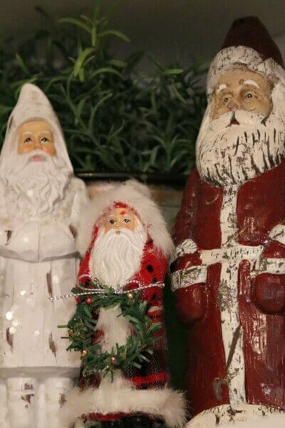 Three santas on kitchen shelf