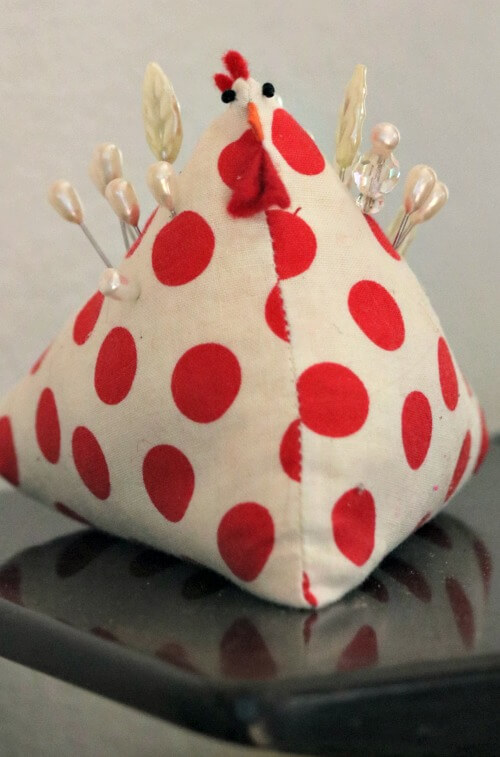 red and beige chicken pin cushion