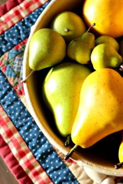 vintage bowl of pears on coffee table