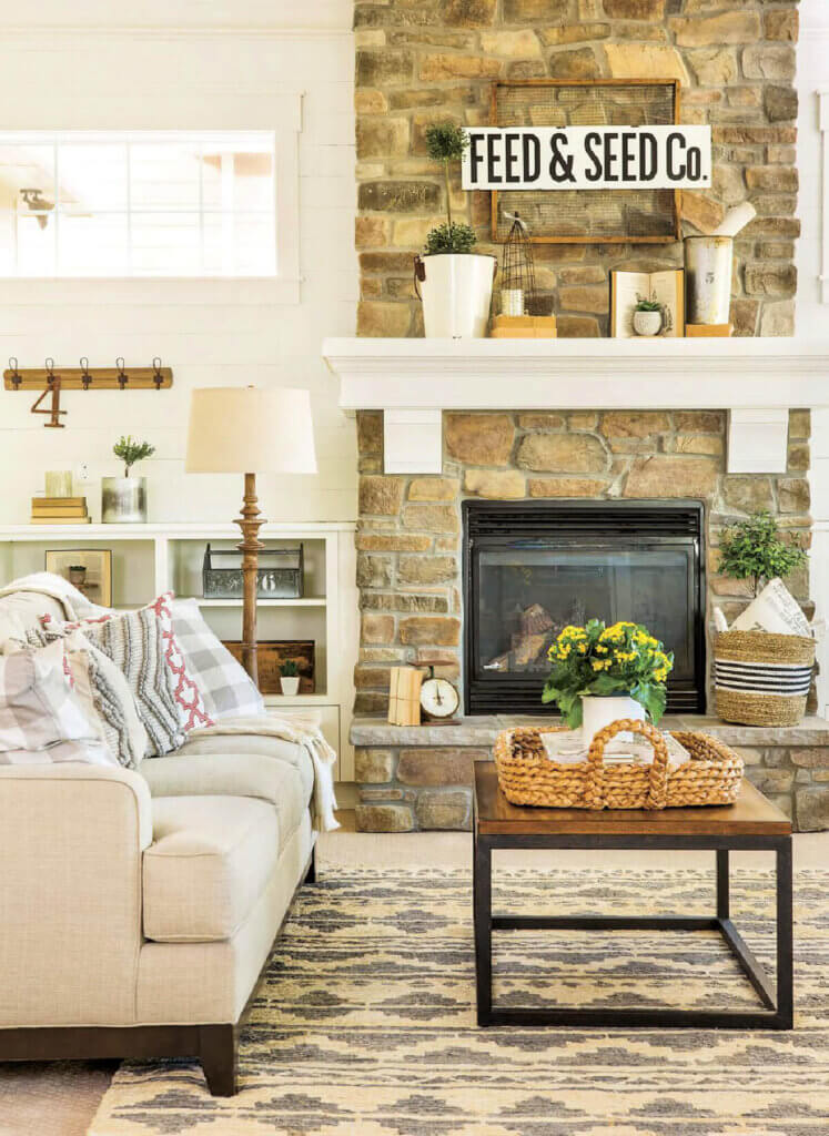 A beige and wood living space with a stone fireplace