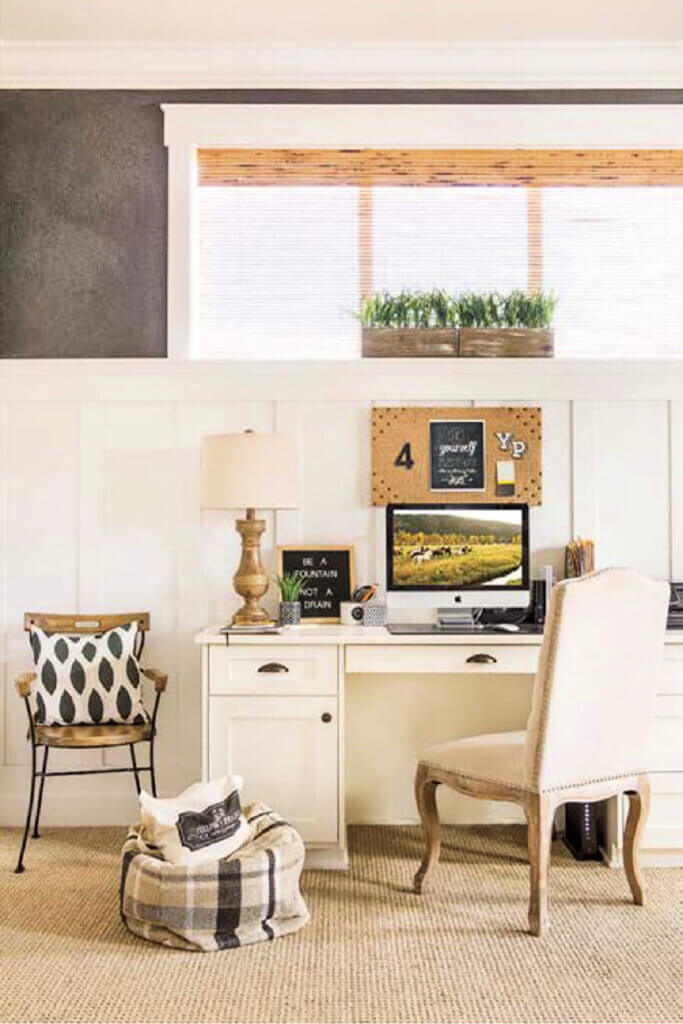 A creamy beige desk and upholstered chair in an office nook