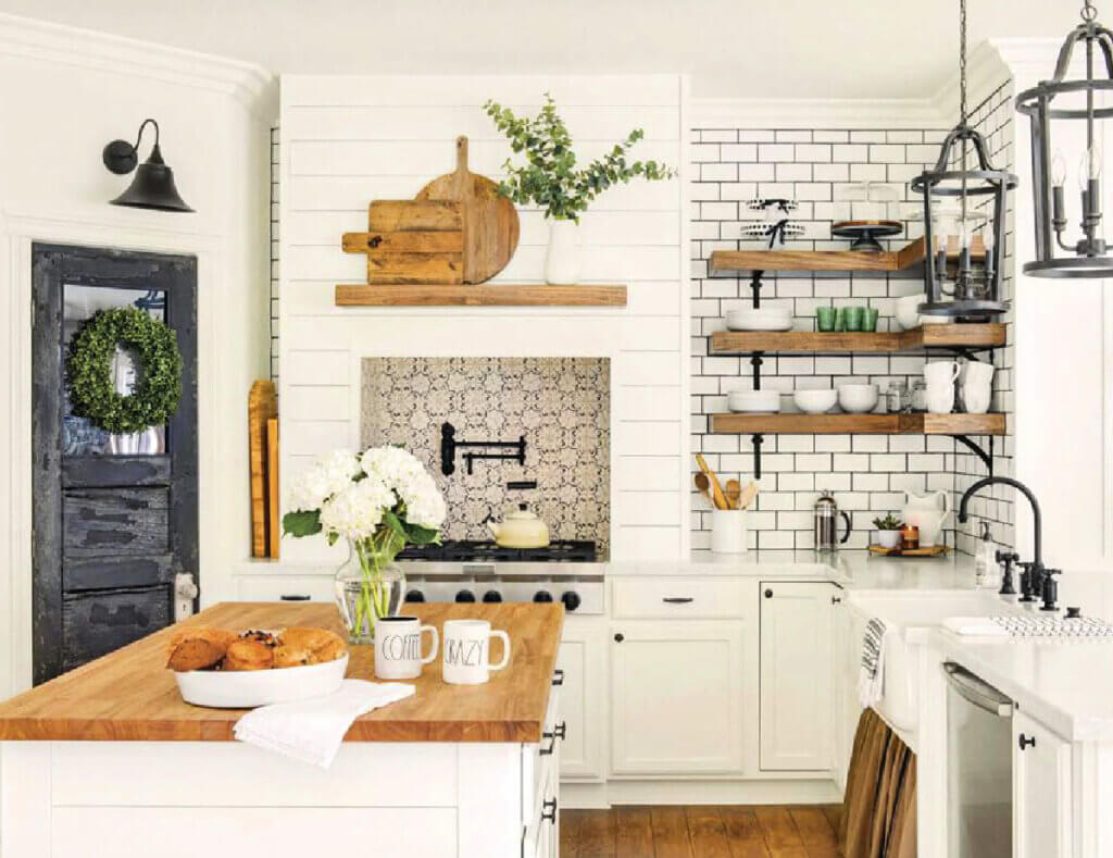 A kitchen with lots of white and wood
