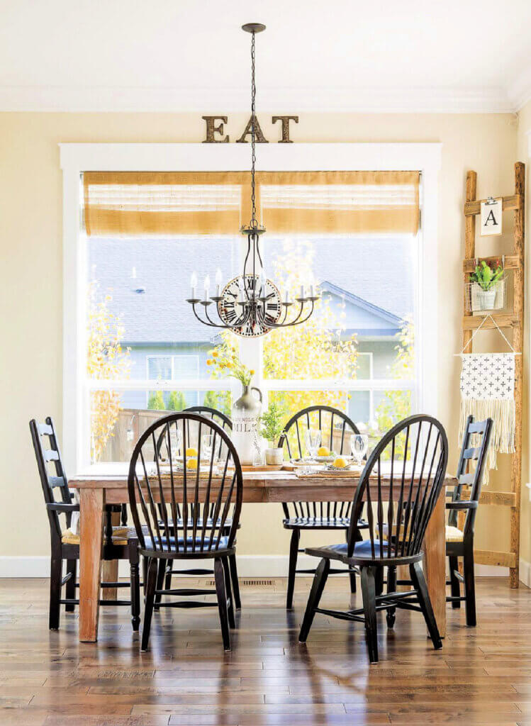 Farmhouse style dining table with two types of black dining chairs
