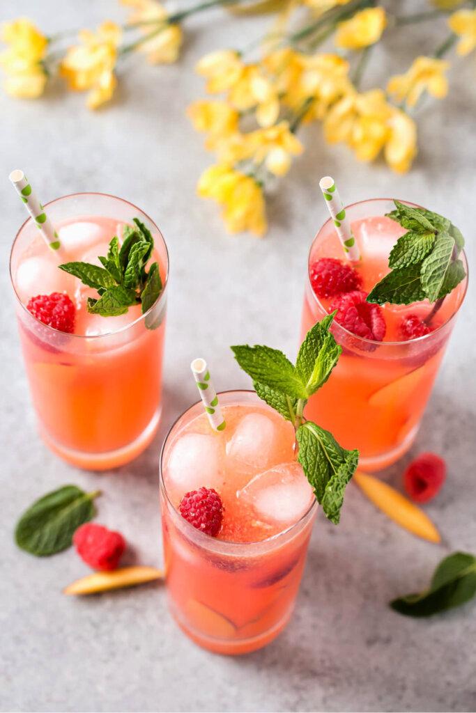 raspberry peach lemonade with a garnish of mint