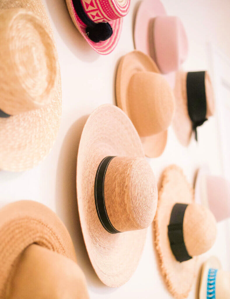 A wall of hats as decor
