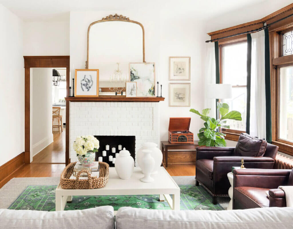 Living room with white brick fireplace and modern chairs