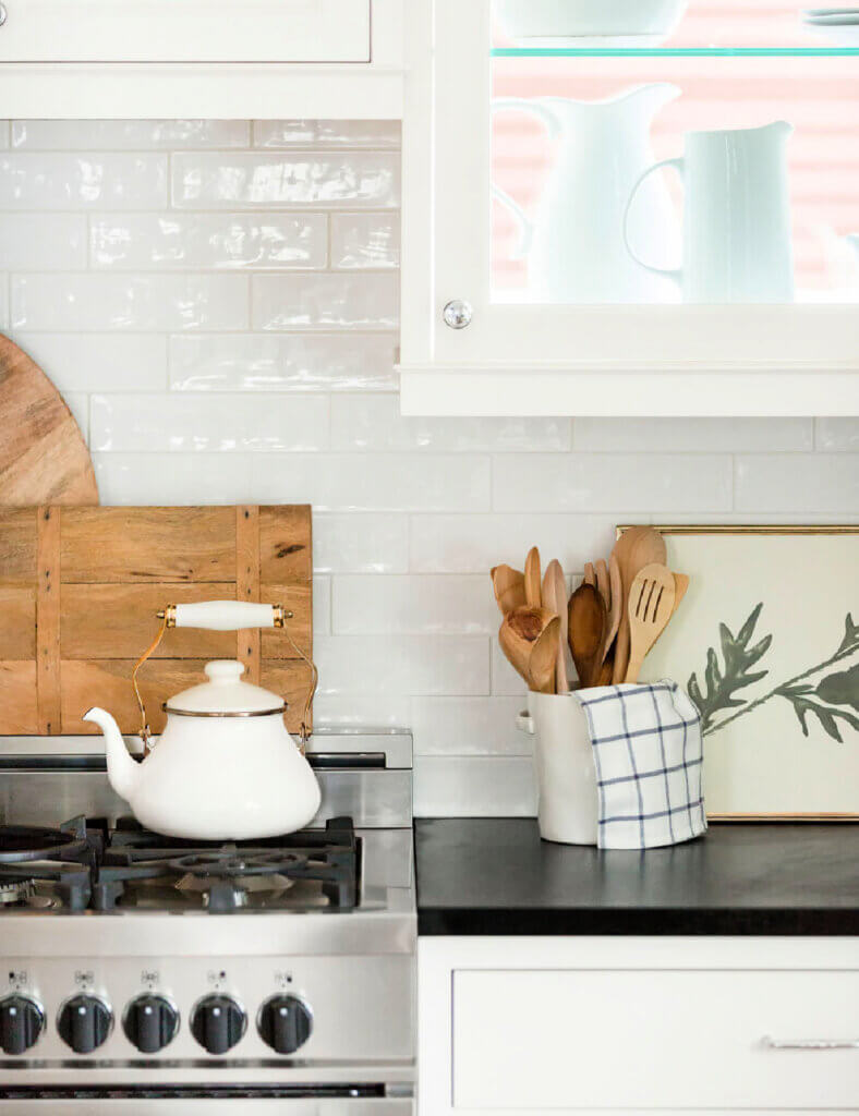 Modern white kitchen with black counter tops and vintage decor