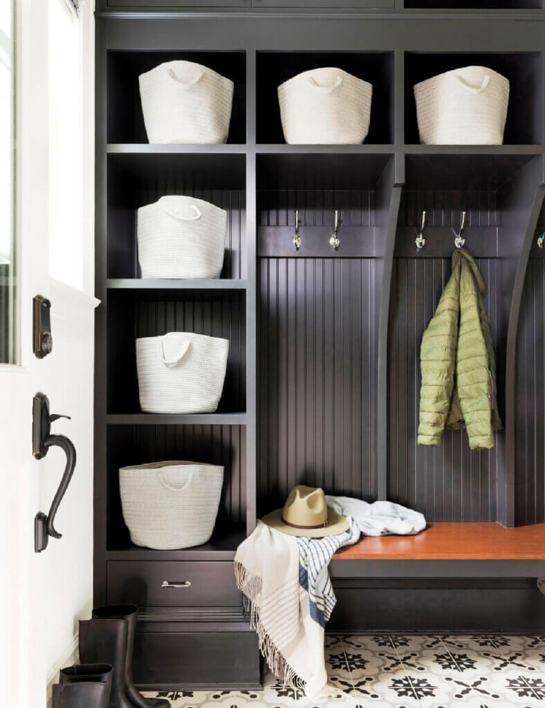 Mudroom with black wood cubbies and shelves