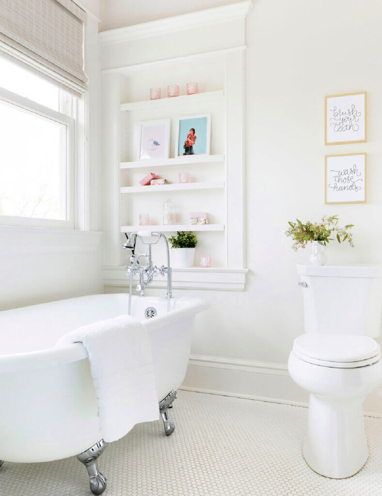 Bathroom with white claw foot tub and white decor and walls