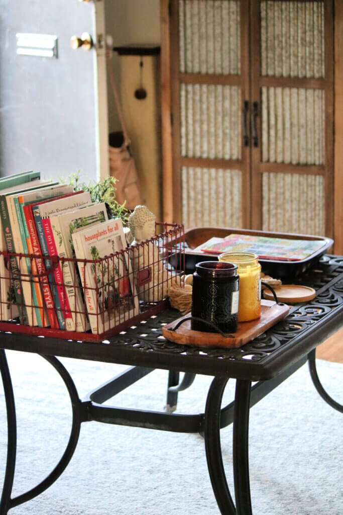 Outdoor patio coffee table with books, magazines and candles