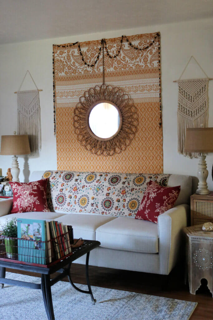 Beige couch with boho accessories. French country red and beige couch pillow covers