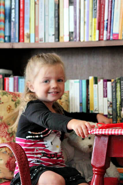 My granddaughter Marley at about 3-4 sitting at a desk in my living room