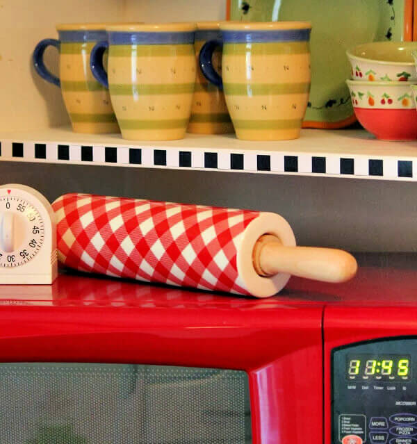 My red microwave with a checked rolling pin on top.