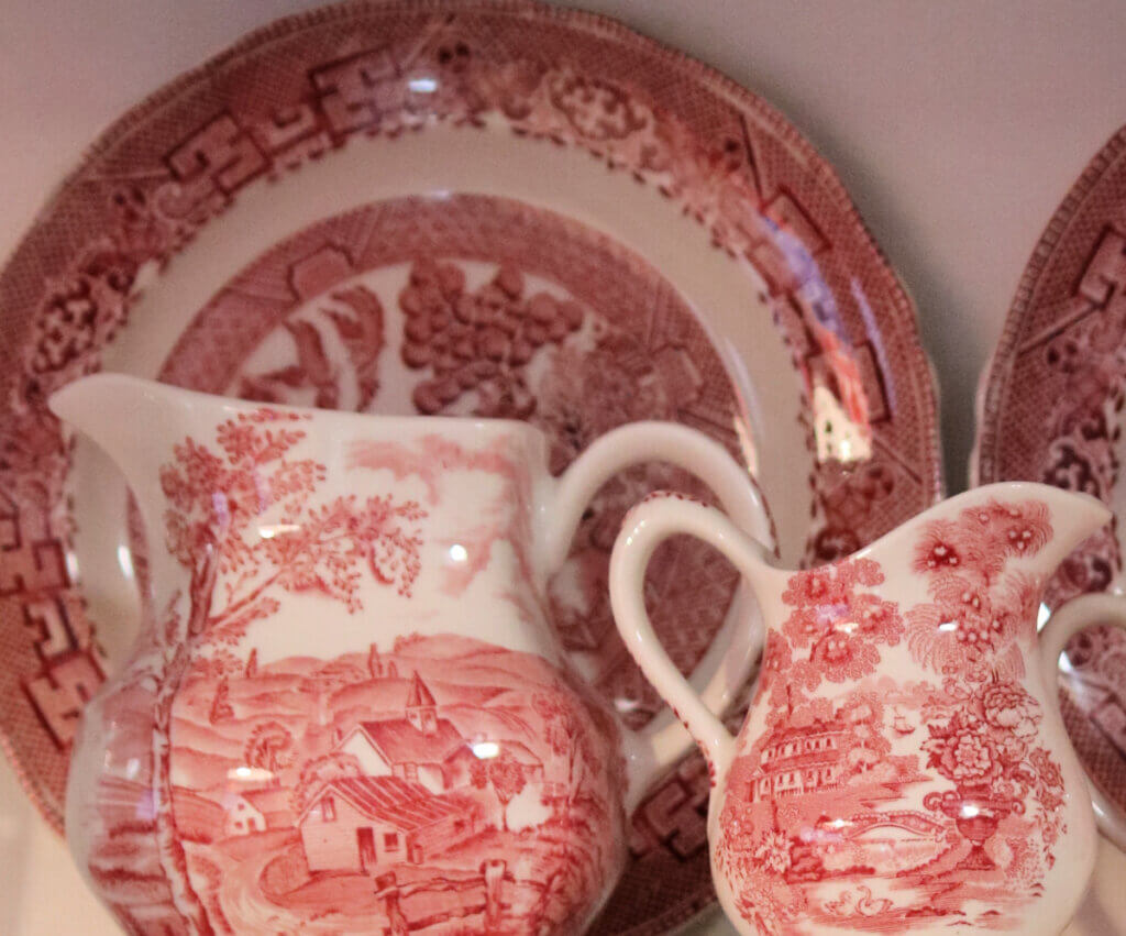 red and white transferware in my open kitchen cabinets