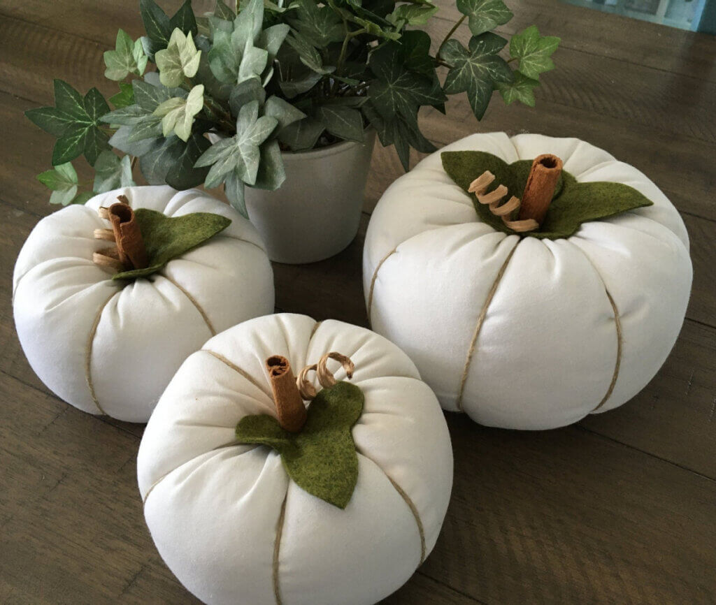 White fabric pumpkins tied with jute at an Etsy shop for fall decor