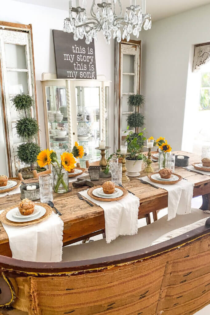 A rustic table with early fall finds of fall decor creating tablescapes