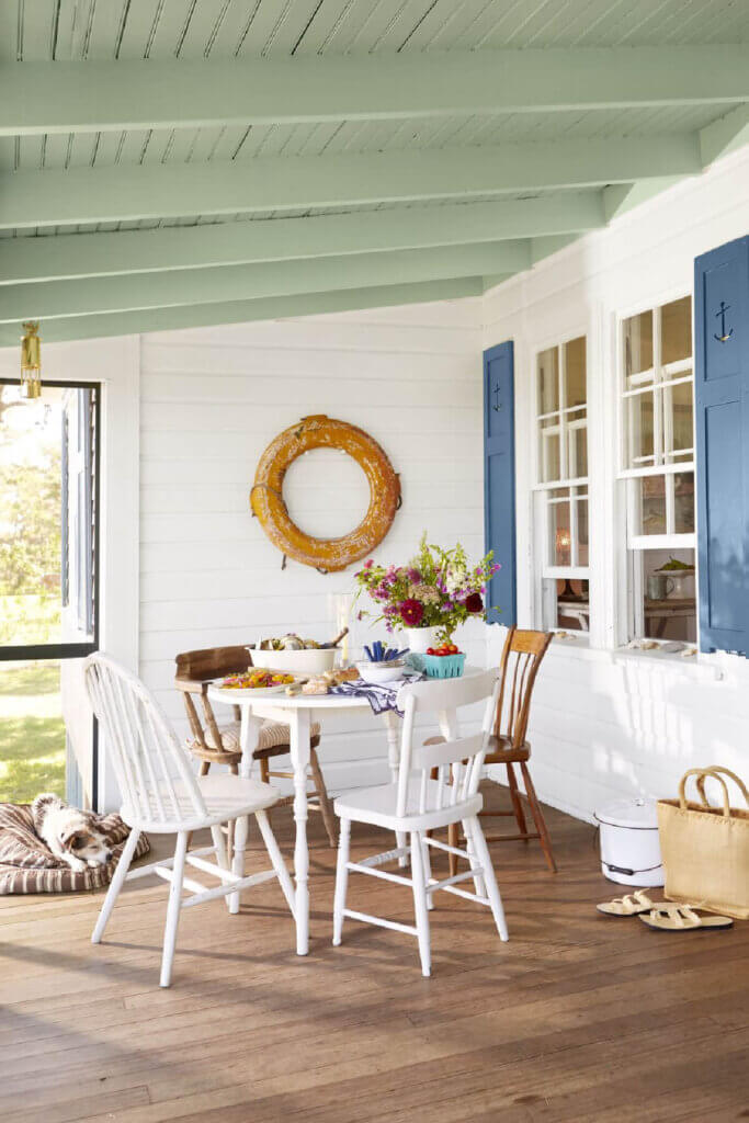 The porch of this Martha's Vineyard beach cottage opens to the water.
