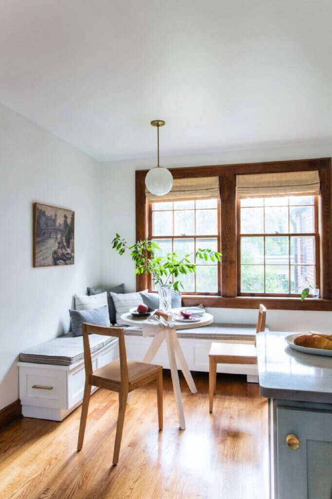 The small dining space with banquette seating in Amber and Adam's Tennessee Tudor home