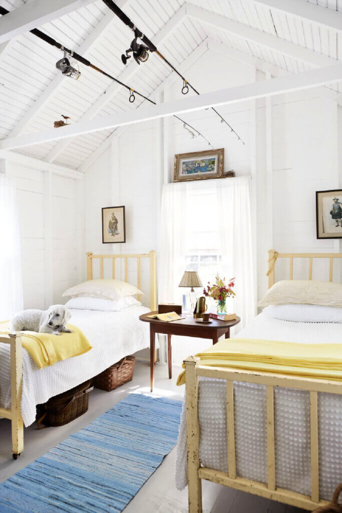 Vintage twin beds are in one guest bedroom of the Martha's Vineyard beach cottage.